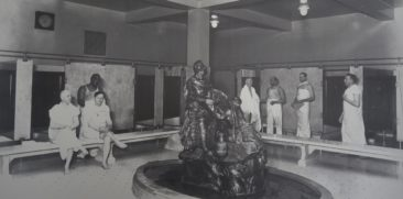 Image of white bathers being massaged and cleaned by black workers in one of the bathhouses in Hot Springs NP.