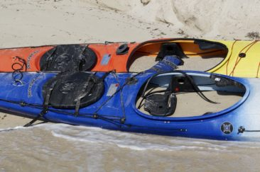 A pair of neglected kayaks... Even though they aren't the best boats, it still hurts to see them full of sand.
